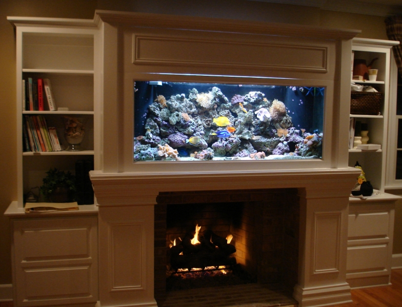 an aquarium next to the fireplace in the living room is good feng shui vina feng shui viet. Black Bedroom Furniture Sets. Home Design Ideas